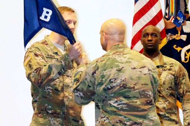 FORT BENNING, Ga. (May 10, 2018) -- U.S. Army Reserve Capt. Andrew V. Burns, left, 98th Training Division (Initial Entry Training), accepts the unit colors of Bravo Company, 2nd Battalion, 11th Infantry Regiment, from the battalion commander, Lt. Col. James Zanella, during a change of command ceremony April 25 at Fort Benning, Georgia. Burns, a native of Indianapolis, is the first Army Reserve Soldier in more than 30 years to take command of the active-duty Infantry Officer Leaders Course. (U.S. Army Reserve photo by Maj. Michelle Lunato/released)
