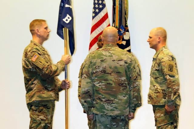 FORT BENNING, Ga. (May 10, 2018) -- U.S. Army Reserve Capt. Andrew V. Burns, left, 98th Training Division (Initial Entry Training), holds the unit colors of Bravo Company, 2nd Battalion, 11th Infantry Regiment, during a change of command ceremony April 25 at Fort Benning, Georgia. Burns, a native of Indianapolis, is the first Army Reserve Soldier in more than 30 years to take command of the active-duty Infantry Officer Leaders Course. (U.S. Army Reserve photo by Maj. Michelle Lunato/released)
