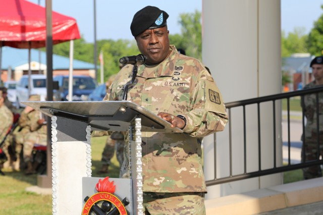 Brig. Gen. David Wilson gives remarks after relinquishing command of The U.S. Army Ordnance School to Brig. Gen. Heidi J. Hoyle during a change of command ceremony May 8 at Whittington Field, Fort Lee, Virginia. Wilson's next assignment is as the deputy assistant chief of staff, C/J-4 for U.S. Forces Korea, Camp Humphreys.