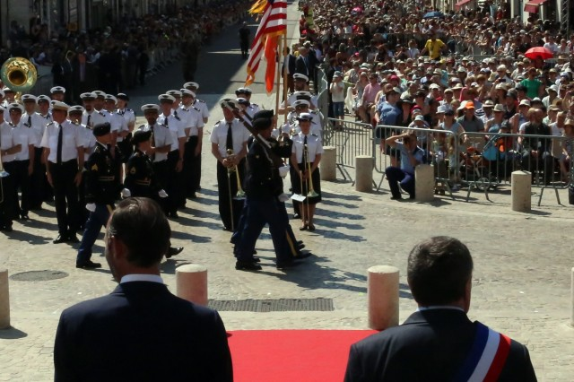 U.S. Soldiers assigned to the 52nd Strategic Signal Battalion, 2nd Theater Signal Brigade, march past French Prime Minister Edouard Philippe (left) and Olivier Carre, mayor of Orleans, at a military parade marking 589 years since Joan of Arc freed the city from the English in the Hundred Years War in Orleans, France, May 8, 2018. (U.S. Army photo by William B. King)