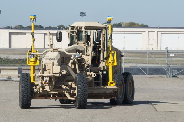 An engineer vehicle exercises the new Enhanced Rapid Airfield Construction Capability (ERACC) system at Fort Bragg, N.C. after an airdrop test.