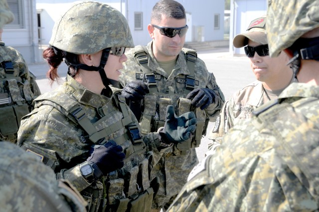 Kosovo soldier Cpl. Donjeta Krasniqi (left), explosive ordinance detonation (EOD) technician, assigned to the Kosovo Civil Protection Regiment, translates training questions to observer coach/trainer Sgt. 1st Class Randon Sanders (right), assigned to the Joint Multinational Readiness Center, during Combined Resolve X, April 27, 2018. Combined Resolve X includes approximately 3,700 participants from 13 nations at the 7th Army Training Command's Grafenwoehr and Hohenfels Training Area, April 9 to May 12, 2018. Combined Resolve is a U.S. Army-Europe-directed multinational exercise series designed to give the Army's regionally allocated combat brigades to Europe a combat training center rotation with joint, multinational environment.