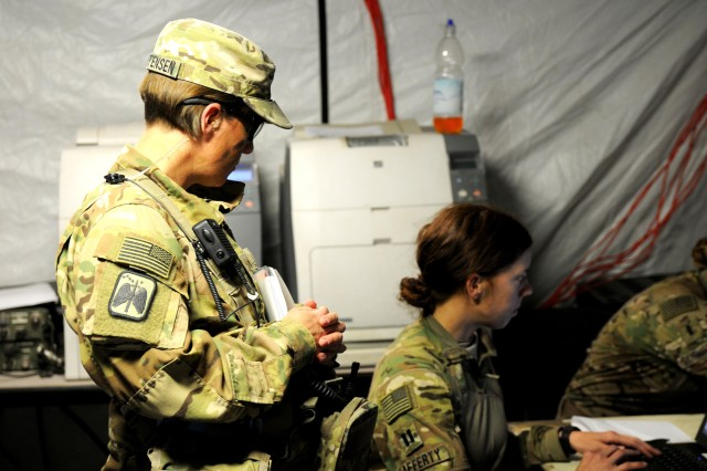 U.S. Army Maj. Pearl Christensen (left), and Cpt. Kaitlin Lafferty, assigned to 2nd Armored Brigade Combat Team, 1st Infantry Division, from Ft. Riley, Kan., conduct intel operations during Combined Resolve X, May 6, 2018. Combined Resolve X includes approximately 3,700 participants from 13 nations at the 7th Army Training Command's Grafenwoehr and Hohenfels Training Area, April 9 to May 12, 2018. Combined Resolve is a U.S. Army Europe-directed multinational exercise series designed to give the Army's regionally allocated combat brigades to Europe a combat training center rotation with a joint, multinational environment.