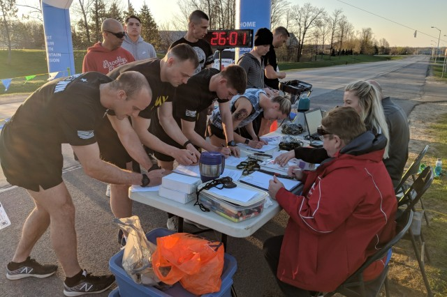 Fort Drum Family and Morale, Welfare and Recreation staff assist 10th Mountain Division (LI) and Fort Drum Soldiers as they register for the 10K qualifier May 9 in hopes of representing their unit and installation at the Army Ten-Miler in October.
