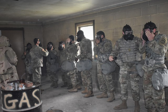 "A Headquarters and Headquarters Battery, 75th Field Artillery Brigade chemical officer runs a training simulation and yells ""Gas! Gas! Gas!"" as Soldiers quickly don and clear their masks. The training, April 30, 2018, at Fort Sill, Okla., gave Soldiers experience and confidence with their equipment knowing it will help them withstand a chemical attack."