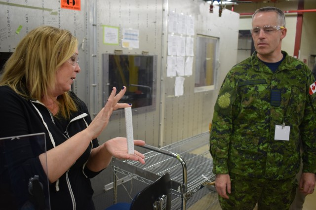 A Crane Army Ammunition Activity supervisor demonstrates countermeasure capabilities to a Canadian delegation April 24-25. The United States continuously collaborates with fellow NATO members Germany, the Netherlands, Denmark and Canada as well as Australia, a close ally, to implement a common method of ammunition management to streamline information sharing during joint operations.