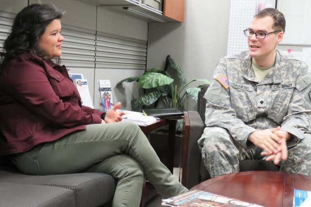 Mary Ball, Madigan Army Medical Center Warrior Transition Battalion transition coordinator, discusses career and education options with Spc. Matthew Rojeski at the WTB on April 17. Ball was named a Regional Health Command-Pacific Civilian Employee of the Year for her work as a transition coordinator.