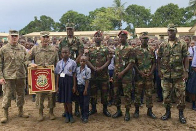 During a visit to the Linda Thomas Greenfield Preparatory School, Maj. Gen. Gregory Vadnais, the adjutant general of the Michigan National Guard, was presented with a plaque in appreciation of his support to the Edward Binyah Kesselly facility and the families of the Armed Forces of Liberia. The children greeted him in their classrooms and showed him what they were learning.