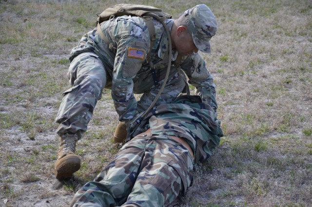 Spc. Weizhe Qi, 175th Financial Management Support Center, Fort Shafter, Hawaii, performs evaluation of a causality during the 2 day Finance Warrior Challenge May 8-9 on Fort Jackson. To become Finance Warrior of the Year Soldiers and Non-Commissioned Officers completed various warrior task and battle drills.
