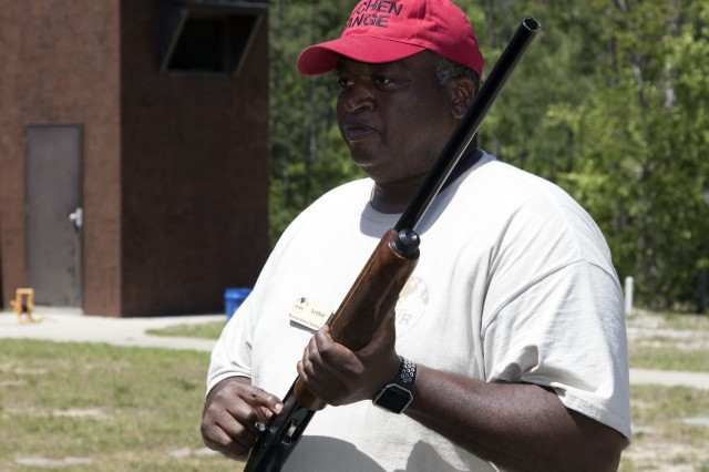 Arthur Hall, with Fort Jackson's Directorate of Family, Morale, Welfare and Recreation, explains how a semi automatic shotgun can be loaded.