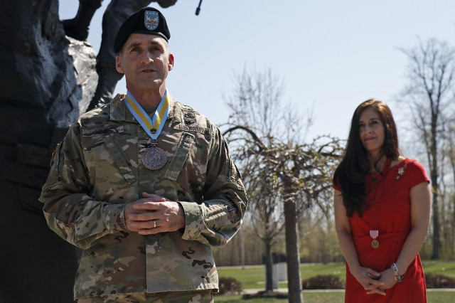 Col. Scott Himes (left), outgoing commander of 2nd Brigade Combat Team, 10th Mountain Division, says a few words after receiving the Order of Saint Maurice for his distinctive service to the infantry, May 9, at Fort Drum, New York. Immediately following the award presentation, Himes passed the torch to Col. Paul Larson during a change of command ceremony on Sexton Field. (U.S. Army photo by Staff Sgt. Paige Behringer)