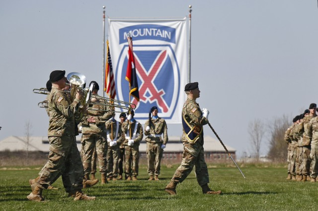The 10th Mountain Division Band marches across Sexton Field during the 2nd Brigade Combat Team change of command ceremony, May 9, at Fort Drum, New York. Col. Scott Himes, the outgoing 2BCT commander, relinquished command of the brigade to Col. Paul Larson. (U.S. Army photo by Staff Sgt. Paige Behringer)