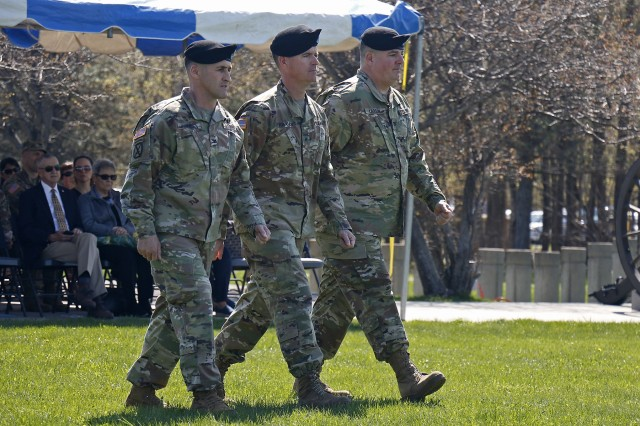 Brig. Gen. Patrick Donahoe (center), 10th Mountain Division acting commanding general, marches alongside Col. Scott Himes (left), and Col Paul Larson, the outgoing and incoming commanders of 2nd Brigade Combat Team, during a change of command ceremony, May 9, at Fort Drum, New York. (U.S. Army photo by Staff Sgt. Paige Behringer)