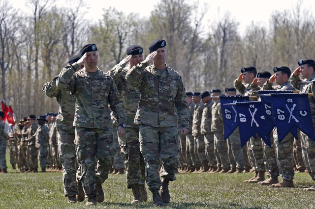 Brig. Gen. Patrick Donahoe (right), 10th Mountain Division acting commanding general, leads the reviewing party of the 2nd Brigade Combat Team change of command ceremony, May 9, at Fort Drum, New York. Col Scott Himes, the 2BCT outgoing commander, passed the torch to Col. Paul Larson. (U.S. Army photo by Staff Sgt. Paige Behringer)