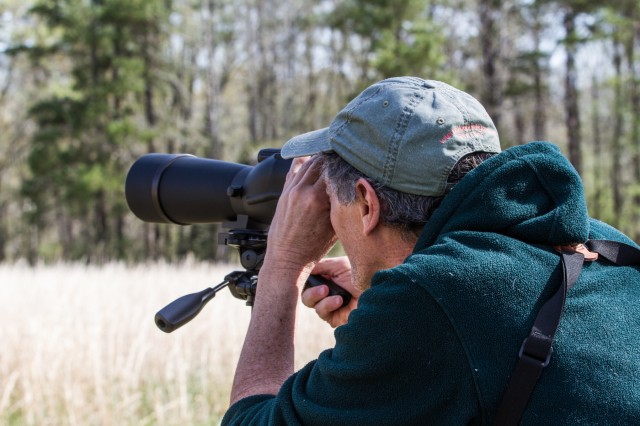 "Daniel Moss, avian ecologist, Fort Campbell Fish and Wildlife, observes the Bald Eagle nest at Fort Campbell. ""We will monitor the nest until completion,"" Moss said. ""Between 74 to 80 days from when the eggs hatched."""