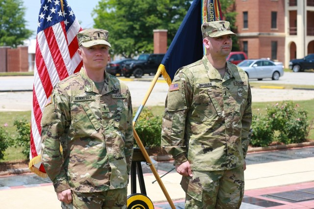 (FORT BENNING, Ga) - 1st Lt. James J. Gusman (right) and 1st Lt Timothy J. Hennessy immediately after the historical first Cyber Direct Commissioning Ceremony on Taylor Field at Fort Benning May 9.