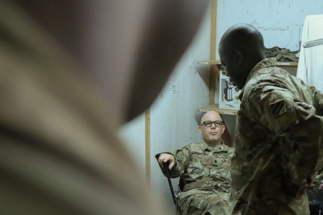 Fort Polk, La., May 4, 2018 - Georgia Army National Guardsman, Lt. Col. Joshua P. Stauffer, medical provider, Charlie Company, 148th Brigade Support Battalion, Macon, Ga., discusses the status of patients during a meeting at the brigade aid station during Joint Readiness Training Center Rotation 18-07.   The brigade medical staff provides full spectrum medical support during the training rotation.Georgia Army National Guard photo by Staff Sgt. R. J. Lannom Jr