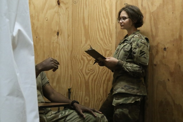 Fort Polk, La., May 4, 2018 - Georgia National Guardsman, Spc. Isabella G. Hannaford, health care specialist, Headquarters and Headquarters Company, 1st Battalion, 121st Infantry Regiment, Winder, Ga., documents a patient's medical issues during Joint Readiness Training Center Rotation 18-07. Hannaford collects information which is provided to medical staff for treatment.Georgia Army National Guard photo by Staff Sgt. R.J. Lannom Jr.
