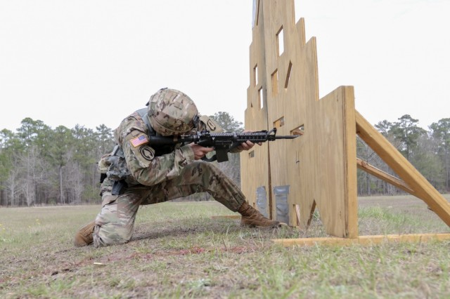 Fort Stewart, Ga., March 6, 2018 - Georgia National Guardsmen Staff Sgt. Kevin M. Daversa, representing 78th Troop Command, fires his weapon during the 2018 Georgia National Guard Best Warrior Competition's 3-Gun event. Daversa had to complete four firing stations on three separate weapons system during the event. (Georgia National Guard photo by Staff Sgt. R.J. Lannom Jr.