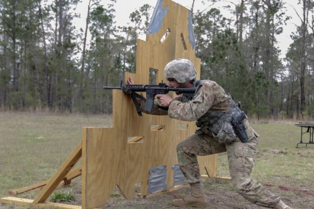 Fort Stewart, Ga., March 7, 2018 - Georgia Army National Guardsman Sgt. Brandon M. Chase, representing 78th Aviation Troop Command, engages a 25-meter target using cover during the 2018 Georgia Army National Guard Best Warrior 3-Gun event. The event tests the Soldiers ability to shoot various weapon systems in different conditions. (Georgia Army National Guard photo by Staff Sgt. R.J. Lannom Jr.)