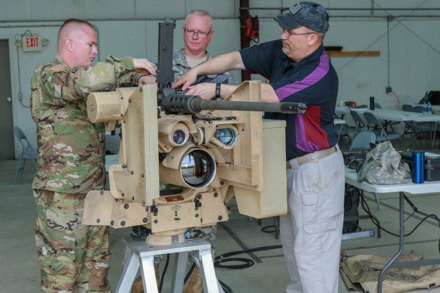 Fort Stewart, Ga., March 20, 2018 - Georgia Army National Guardsmen walk through the final pre-checks of the CROWS firing system under the supervision of a instructor during the CROWS Instructor's Course at the Georgia Garrison training Center.  The Common Remotely Operated Weapon Station is an externally mounted weapons control system that allows the gunner to remain inside the vehicle while firing various crew served Weapons.  (Georgia Army National Guard photo by Staff. Sgt. R.J. Lannom Jr.)