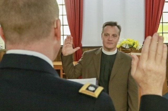 CLAY NATIONAL GUARD CENTER - Marietta, Ga., Feb.22, 2018 - The Rev. Paul McCabe is sworn into the U.S. Army Chaplain's Corps by Lt. Col. Blair Davis, state chaplain, in the Dobbins Chapel.  McCabe is the first Episcopal Chaplain to serve in the Georgia Army National Guard. (U.S. Army National Guard photo by Staff Sgt. R.J. Lannom/Released)