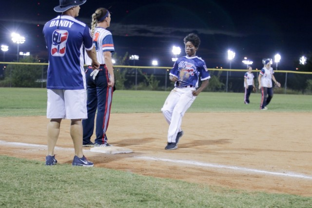 Oklahoma City, Ok., September 30, 2017 - Georgia Army National Guardsman Spc. Corrisa B. Perry, a food service specialist with the 165th Quartermaster Company, (Aerial Delivery Support) comes into third base during the All Armed Forces second game at the USA Softball Women's Open Championship. The team came from behind against Bright Express to win the game in the bottom of the final inning 9-8. (U.S. Army National Guard photo by Staff Sgt. R.J. Lannom Jr/Released)