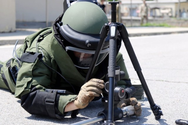 Staff Sgt. Edward Monczynski assigned to 718th Ordnance Co, Explosive Ordnance Disposal from Rochester, New York, prepares to detonate an Improvised Explosive Device (IED) dressed in a bomb suit and armed with a percussion actuated neutralizer at Camp Hovey during training for the Department of the Army Team of the Year. (U.S. Army photos by Spc. Sarah Williams, 2nd Infantry Division/ROK-U.S. Combined Division Public Affairs Office)