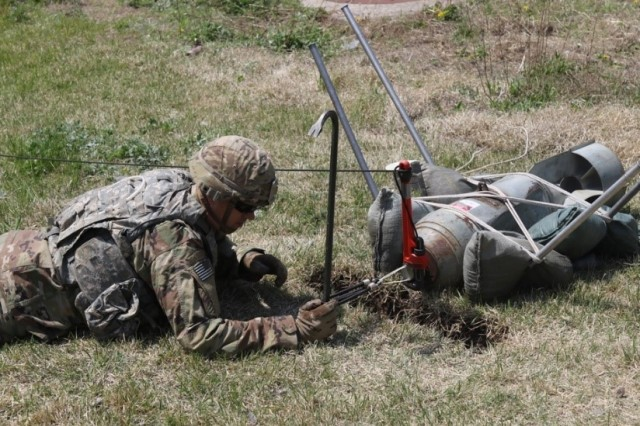 Staff Sgt. Edward Monczynski assigned to 718th Ordnance Co, Explosive Ordnance Disposal from Rochester, New York, prepares to detonate a simulated unexploded bomb that was placed. He remotely removed the fuse using the hook tape and line technique. (U.S. Army photos by Spc. Sarah Williams, 2nd Infantry Division/ROK-U.S. Combined Division Public Affairs Office)