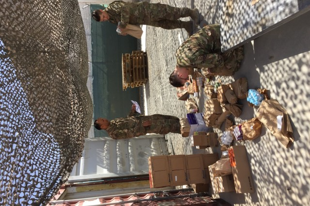 Spc. Daimon Silva, a medical logistics specialist assigned to Charlie Company, 704th Brigade Support Battalion, 2nd Infantry Brigade Combat Team, 4th Infantry Division, distributes medical supplies to the unit personal, March 15, 2018, at Kandahar Airfield, Afghanistan.(U.S. Army photo by 2nd Lt. Wilbert Paige/TAAC-South UPAR)