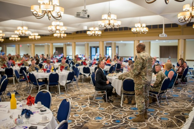 FORT BENNING, Ga. (May 11, 2018) -- Maj. Gen. Gary M. Brito, right, Maneuver Center of Excellence and Fort Benning commanding general, talks to Soldiers, Family members and civilians during a prayer breakfast. Former NFL players, Buddy Curry and Bobby Butler, served as guest speakers during the National Day of Prayer Observance, May 9 at the Benning Club located on post. The National Day of Prayer is an annual observance held in May inviting people of all faith to pray for the nation. (U.S. Army photo by Patrick A. Albright, Maneuver Center of Excellence, Fort Benning Public Affairs)