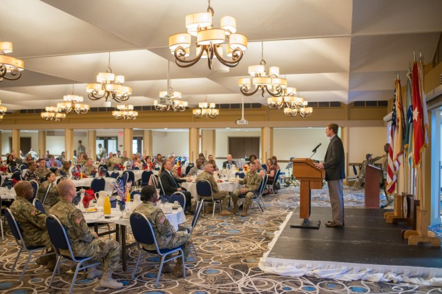 FORT BENNING, Ga. (May 10, 2018) -- Buddy Curry, right, a former linebacker for the Atlanta Falcons football team, talks to Soldiers, civilians and Family members at the Benning Club at Fort Benning, Georgia. Former NFL players, Curry and Bobby Butler, serve as guest speakers during the National Day of Prayer Observance, May 9 at the Benning Club located on post. The National Day of Prayer is an annual observance held in May inviting people of all faith to pray for the nation. (U.S. Army photo by Patrick A. Albright, Maneuver Center of Excellence, Fort Benning Public Affairs)