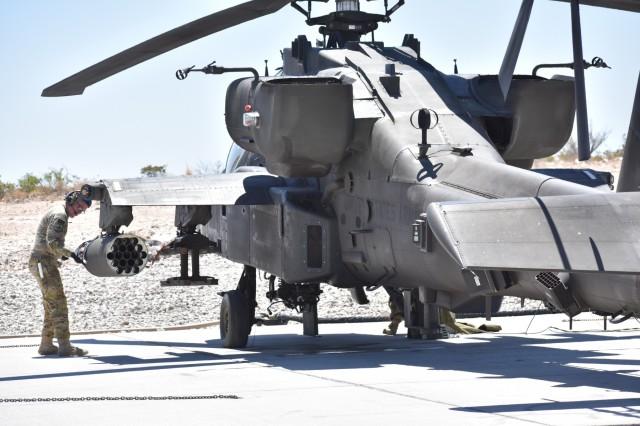 Spc. Joshua Beer, an AH-64 armament, electric, avionic systems repairer assigned to 1st Battalion, 501st Aviation Regiment, Combat Aviation Brigade, 1st Armored Division, loads 2.75-inch Folding-Fin Aerial Rockets onto an AH-64 Apache helicopter at Range 83 at Orogrande, N.M., April 23, 2018.