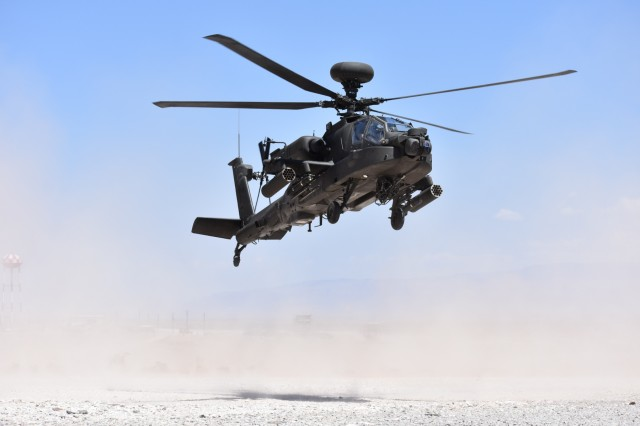An AH-64 Apache helicopter lands at a Forward Arming and Refueling Point during a 1st Battalion, 501st Aviation Regiment, Combat Aviation Brigade, 1st Armored Division, gunnery at Range 83 at Orogrande, N.M., April 23, 2018.
