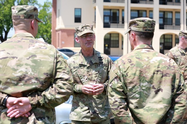 (FORT BENNING, Ga) - Brig. Gen. Neil S. Hersey, commandant, U. S. Army Cyber School, Fort Gordon, Ga., administers the oath of office to 1st Lt. James J. Gusman and 1st Lt. Timothy J. Hennessy during the Cyber Direct Commissioning Ceremony on Taylor Field at Fort Benning, May 9.