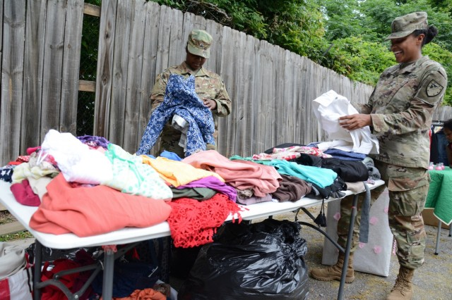 FORT BENNING, Ga. (May 11, 2018) -- Soldiers from the 316th Cavalry Brigade on Fort Benning, Georgia, donate approximately 500 pieces of clothing May 10 to Hope Harbour, a local domestic violence shelter in Columbus, Georgia. The clothing drive was established to help the women celebrate Mother's Day and was in conjunction with the shelter's annual Mother's Day dinner. (U.S. Army photo by by Megan Garcia, Maneuver Center of Excellence, Fort Benning Public Affairs)