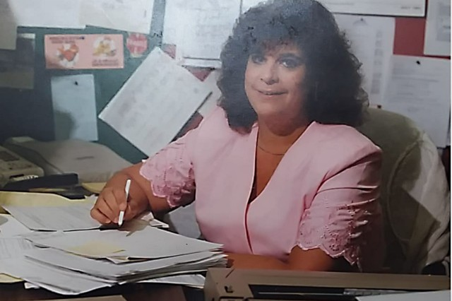 Cheryl Michener at her desk in Buffalo, New York, while serving as an administrative assistant for U.S. Army Corps of Engineers, Buffalo District, engineering design branch, in the late 1980s.