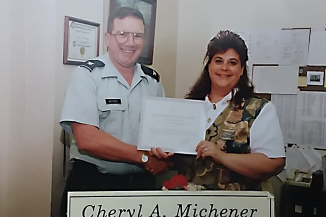 Cheryl Michener being presented an award by one of her many past commanders, while serving as administrative assistant for the U.S. Army Corps of Engineers, Buffalo District, engineering planning division, in the early 1990s.