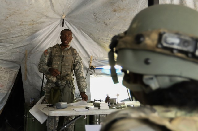 Fort Polk, Ga., May 13, 2018 - Georgia National Guardsmen attend religious services held during Joint Readiness Training Center Rotation 18-07. Cpt. Anthony Amos, chaplain, Headquarters and Headquarters Company, 177th Brigade Engineer Battalion, Statesboro, Ga., leads the service.