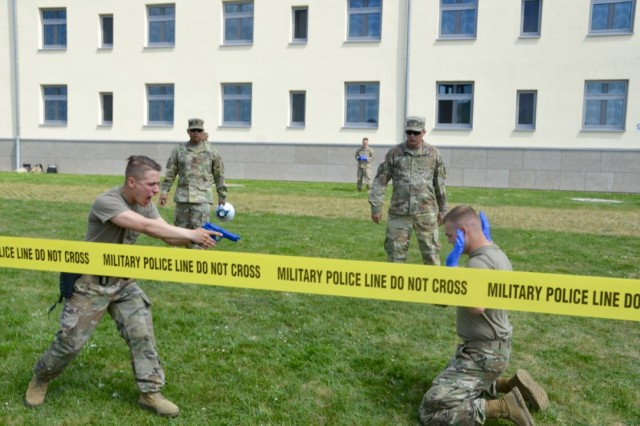Pvt. Second Class Colby Andersen takes control of a 'suspect' while dealing with the effects of pepper spray during a recent OC training as part of Installation Law Enforcement Certification at USAG Ansbach.