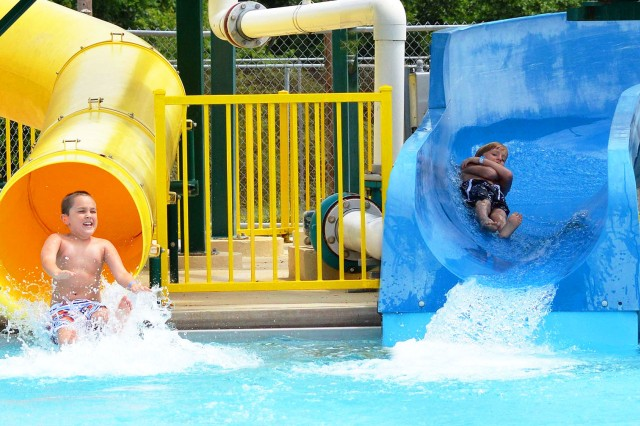 Children race down the double flume slides as they enjoy a day at SPLASH! Pool and Spray Park.