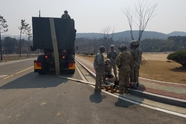 Soldiers from the 339th Quartermaster Company and the 498th Combat Service Support Battalion used existing culverts to thread 9,500 feet of lay-flat hose though pipes during the Combined Joint Logistics Over-the-Shore exercise at Pohang, South Korea, last spring. The hose is part of the Fight Tonight Emergency Fuel Distribution System, which can deliver 720,000 gallons of fuel per day.