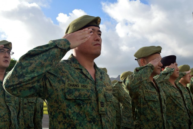 Soldiers assigned to the 6th Division, Singapore Army and 10th Singapore Infantry Brigade salute during playing of national anthems during the opening ceremony of Tiger Balm 18 at the 298th Regiment, Multi-Functional Training Unit (MFTU), Regional Training Institute (RTI), Waimanalo, Hawaii, on May 14, 2018. Tiger Balm is an annual bilateral military exercise designed to enhance the professional relationship, combat readiness, and interoperability between the US and Singapore, and fulfill and demonstrate regional security partnership and resolve. (U.S. Army photo by Staff Sgt. Armando R. Limon, 3rd Brigade Combat Team, 25th Infantry Division)