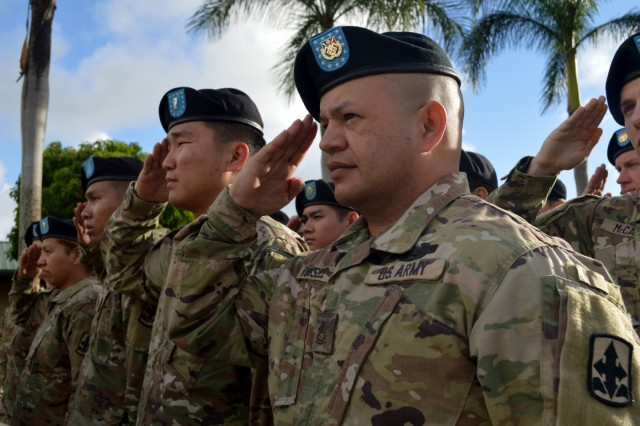 U.S. Soldiers assigned to the 3rd Brigade Combat Team (3BCT), 25th Infantry Division (25ID); the 29th Infantry Brigade Combat Team (29IBCT), Hawaii Army National Guard (HIARNG); 426th Civil Affairs Battalion, California Army National Guard (CARNG) salute during the playing of the national anthems during the opening ceremony of Tiger Balm 18 at the 298th Regiment, Multi-Functional Training Unit (MFTU), Regional Training Institute (RTI), Waimanalo, Hawaii, on May 14, 2018. Tiger Balm is an annual bilateral military exercise designed to enhance the professional relationship, combat readiness, and interoperability between the US and Singapore, and fulfill and demonstrate regional security partnership and resolve. (U.S. Army photo by Staff Sgt. Armando R. Limon, 3rd Brigade Combat Team, 25th Infantry Division)