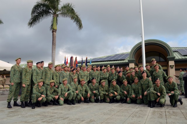 Members of the 6th Division, Singapore Army and 10th Singapore Infantry Brigade at the opening ceremony of Tiger Balm 18 at the 298th Regiment, Multi-Functional Training Unit (MFTU), Regional Training Institute (RTI), Waimanalo, Hawaii, on May 14, 2018. Tiger Balm is an annual bilateral military exercise designed to enhance the professional relationship, combat readiness, and interoperability between the US and Singapore, and fulfill and demonstrate regional security partnership and resolve. (U.S. Army photo by Staff Sgt. Armando R. Limon, 3rd Brigade Combat Team, 25th Infantry Division)