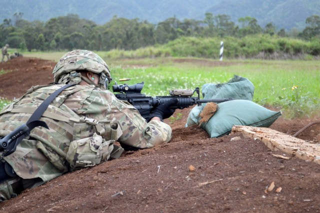 "Maj. Matthew Krog, assigned to the 3rd Brigade Combat Team, ""Broncos,"" 25th Infantry Division, fires during a stress shoot as part of a Mungadai exercise at Schofield Barracks, Hawaii, on April 17, 2018. The Mungadai is used as a Bronco Brigade leader development program is to create disciplined, trained, and ready professionals, prepared with operational and foundational knowledge, to take disciplined initiative while implementing and executing their commander's intent. (U.S. Army photo by Staff Sgt. Armando R. Limon, 3rd Brigade Combat Team, 25th Infantry Division)"