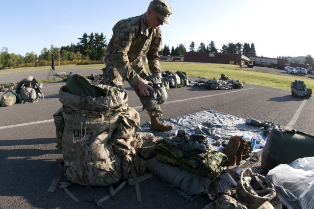 1st Sgt. Scott Kelsey, first sergeant for B Battery, 5th Battalion, 3rd Field Artillery Regiment, unpacks his ruck sack prior to the TA-50 layout for I Corps Best Warrior Competition (BWC) at Joint Base Lewis-McChord on May 14, 2018. The BWC is held to measure soldier's technical and tactical abilities while competing in high stress situations. (U.S. Army photo by Sgt. Kyle Larsen)