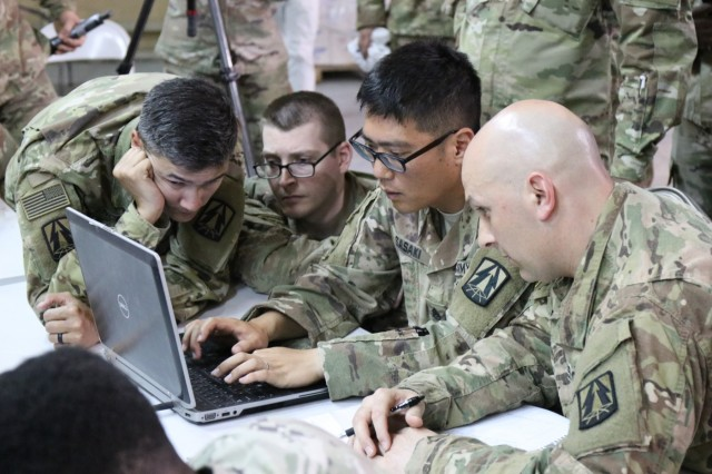 335th Signal Command (Theater) (Provisional) team participates in Best Cyber Ranger competition, Camp Arifjan, Kuwait, May 8. (Official Army Reserve photo by Maj. Andrew Benbow)