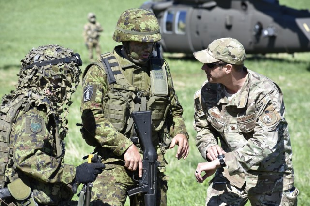 U.S. Air Force Maj. Karl Hurdle, Air Liaison Officer with Okla. National Guard's 146th Air Support Operations Squadron, advises Lt. Janno Õsso, Estonian Defense Force's 2nd brigade ALO, on Joint Terminal Attack Controller capabilities May 9th during Exercise HEDGEHOG 2018 in Southern Estonia. The Tactical Air Control Party members served as advisers to the Estonian Defense Force to create combined fires between U.S. Army and multinational aviation assets.