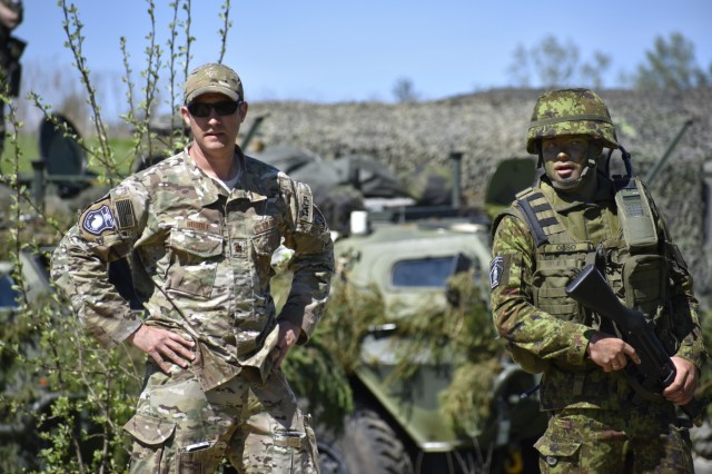 U.S. Air Force Maj. Karl Hurdle, Air Liaison Officer with Okla. National Guard's 146th Air Support Operations Squadron, advises Lt. Janno Õsso, Estonian Defense Force's 2nd brigade ALO, on Joint Terminal Attack Controller capabilities May 9th during Exercise HEDGEHOG 2018 in Southern Estonia. The TACP personnel served as advisers to the Estonian Defense Force to create combined fires between U.S. Army and multinational aviation assets.